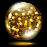 Sphere with gold sparkles. Glass sphere filled with golden glowing sparkles with bokeh effect. Sphere with gold sparkles, glares and shadow. Used only on dark Royalty Free Stock Images