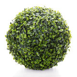 Sphere from green artificial grass  on white background Royalty Free Stock Photos