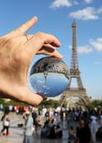 Sphere on the hand and the Eiffel Tower in Paris stock photo