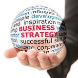 Sphere in hand with inscription business strategy Stock Images