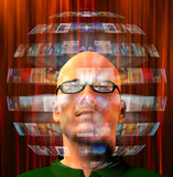 Sphere of images around mans head Stock Photography