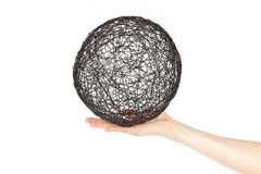 Sphere from a metal wire on a human palm Stock Photography