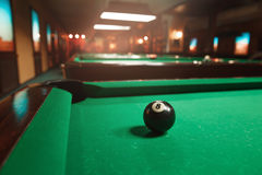 Sphere number 8 opposite to a billiard pocket Royalty Free Stock Photos
