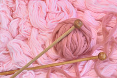 Sphere of pink wool with needles Royalty Free Stock Image