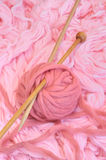 Sphere of pink wool with needles Stock Photos