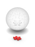 Sphere of puzzles and red element Stock Photography