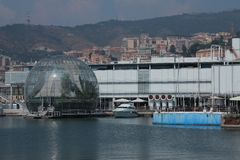 The sphere of Renzo Piano at the port of Genoa. The sphere of Renzo Piano and the aquarium at the port of Genoa Stock Photos