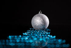 Sphere with ribbon on black Stock Image