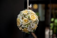 Sphere shape flower bouquet hanging on dark background royalty free stock photography