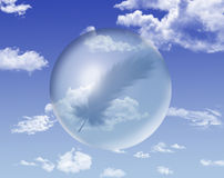 Sphere on the sky with a feather inside Royalty Free Stock Photography