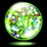 Sphere with sparkles in green colors. Green glass sphere filled with multicolored glowing sparkles with bokeh effect. Sphere with colored sparkles, glares and Royalty Free Stock Photography