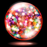 Sphere with sparkles in red colors. Red glass sphere filled with multicoloredglowing  sparkles with bokeh effect. Sphere with colored sparkles, glares and shadow Royalty Free Stock Image