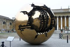 Sphere within sphere. Modern sculpture located in the Courtyard of the Pinecone at Vatican Museums. Sphere created by Italian sculptor Arnoldo Pomodoro Stock Photography