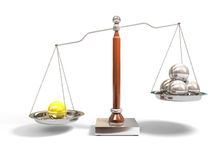 Spheres on balance scale Stock Photos