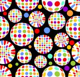 Spheres with colorful dots - seamless high contrasting vector background. Cheerful polka globe elements on black background. EPS 1 Royalty Free Stock Image