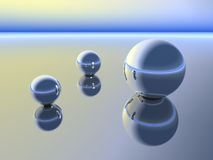 Spheres in Conversation. Shiny clean chrome globes in an abstract form of conversing Royalty Free Stock Image