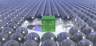 Spheres and a cube. A background of blue spheres and a single green cube Royalty Free Stock Images