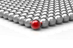 Spheres leadership concept. 3D render of bunch of chromed spheres with a red sphere in front symbolizing leadership Stock Images