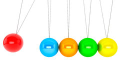 Spheres of Newton. Perpetual motion concept. Colorful newton's cradle on a white background Royalty Free Stock Image