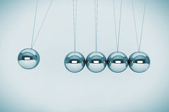 Spheres of Newton. Perpetual motion concept. Spheres of Newton on a white background Stock Photography
