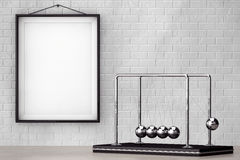Spheres of Newton in front of Brick Wall with Blank Frame Stock Photos