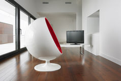 Spherical armchair and living room. stock image