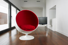 Spherical armchair and living room. royalty free stock image