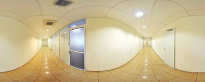 Spherical 360 degrees panorama projection, panorama in interior empty long corridor with doors and entrances to different rooms. Spherical 360 degrees panorama Stock Photography