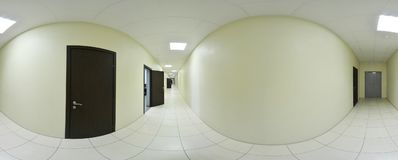 Spherical 360 degrees panorama projection, panorama in interior empty long corridor with doors and entrances to different rooms. Royalty Free Stock Photography