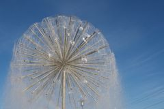 Spherical fountain on blue sky Royalty Free Stock Photography