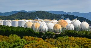 Spherical gas tanks. At the autumn forest in Okayama, Japan Royalty Free Stock Images