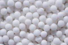Spherical homeopathic pills closeup Stock Photos
