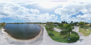 360 spherical image of a lake with fitness trail Stock Images