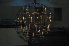 Spherical iron chandlier with a cross inside Stock Photos