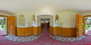 360 panorama of the Catholic chapel entrance in Vármező Câmpu Cetății / Burgfeld, Transylvania, Romania. 360 spherical panorama of the entrance Royalty Free Stock Image