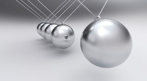 Spherical silver pendulum Stock Images