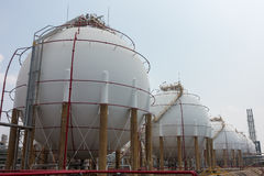 Spherical tanks under cloudy weather Royalty Free Stock Photography