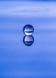 Spherical water droplet reflected Stock Photo
