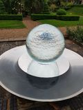 Spherical water feature fountain royalty free stock image