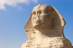 The Sphinx. The Great Sphinx of Giza is a statue of a reclining lion with a human head that stands on the Giza Plateau on the west bank of the Nile, near modern Royalty Free Stock Photos