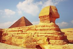 Sphinx. Statue and pyramid of Cheops on the background. Giza plateau in Egypt Stock Photography