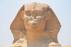 Sphinx. The wonderfull and misterious Sphinx guardian of King's valley in Gizah with the Cheope's pyramid on the back Stock Photography