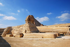 Sphinx. And pyramids - tombs of the pharaohs in Giza, Egypt Royalty Free Stock Photography