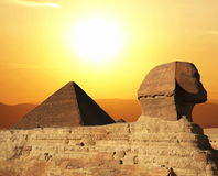 Sphinx. Egyptian sphinx and pyramid on sunset royalty free stock images