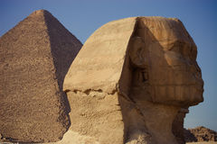 Sphinx. The sphinx in cairo near a pyramid Royalty Free Stock Image