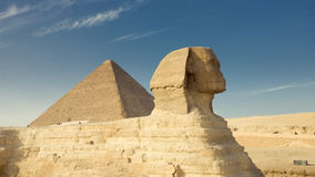 Sphinx. The sphinx in cairo near a pyramid Royalty Free Stock Photography