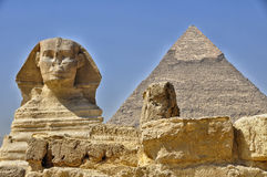 Sphinx against of Giza pyramid Stock Photo