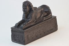 Sphinx ancient figure of shungite. In ancient Egyptian art-an animal with a lion`s body, the head of a man.Sphinx is one of the most unusual and rare domestic stock image
