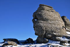 The Sphinx from Bucegi Mountains. Bucegi Mountains, Sphinx Natural Monument, photo taken in a cold winter Royalty Free Stock Images