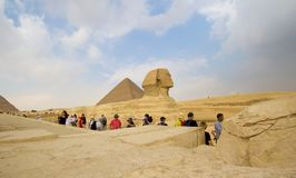 The Sphinx. Cairo, Egypt – November 12, 2018: photo for the Sphinx in the Pyramids of Giza in Cairo city capital of Egypt. and some tourists stock images
